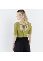 Small lime green sweater, with short knit sleeves, lined with a ribbon tied on the back