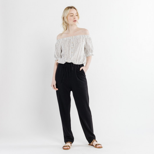 Black supple linen trousers, with 4 applied pockets, elasticated waist.