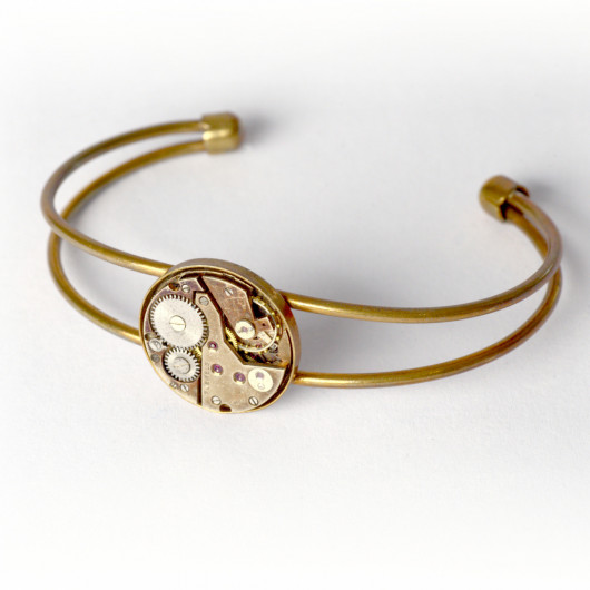 Bronze bracelet with genuine old swiss watch movement with ruby