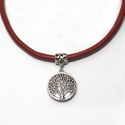 Red leather necklace and reversible silver chiselled Tree of Time pendant with Art Deco ironwork